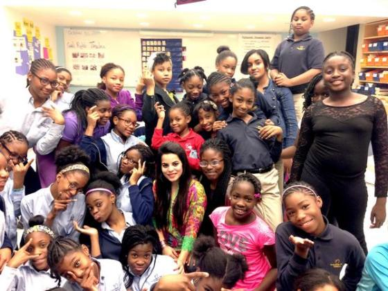 Galit (taking the photo), Vaishali and I with a group of middle school girls excited about Dance to Unite and learning Kathak!